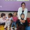 pre-school teacher and students are smiling