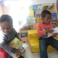 two kids are reading
