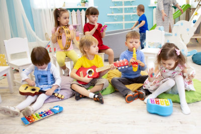 group of children learning to play a music instruments